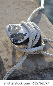 nautical rope tied around a rock being used as a capstone