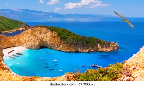 Navagio bay and Ship Wreck beach in summer. The most famous natural landmark of Zakynthos, Navahio Bay. One of the most beautiful places in the World. View from a height of more than 500 meters.