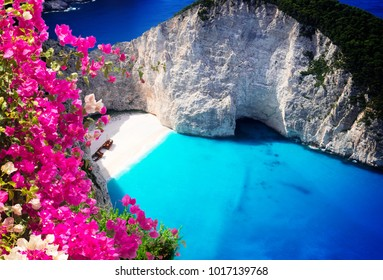 Navagio beach, famous overhead summer lanscape of Zakinthos island, Greece with flowers
