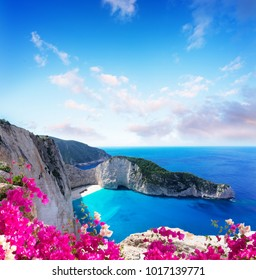 Navagio beach rocks, famous overhead lanscape of Zakinthos island, Greece with flowers