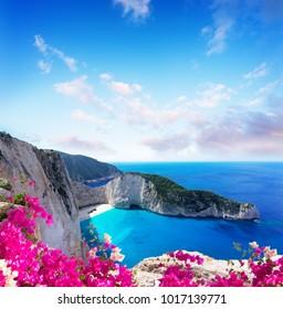 Navagio beach rocks, famous overhead lanscape of Zakinthos island, Greece with flowers