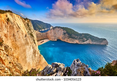 Navagio Beach with shipwreck view on Zakynthos island, Greece. Incredibly romantic sunrise on Zakinthos. Amazing sunset view with multicolored clouds. Island of lovers.