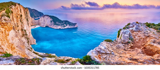 Navagio Beach with shipwreck view on Zakynthos island, Greece. Incredibly romantic sunrise on Zakinthos. Amazing sunset view with multicolored clouds. Island of lovers. Doors to heaven