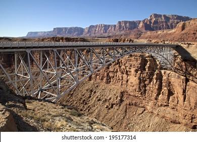 Navajo Bridge and Vermillion Cliffs in background, AZ