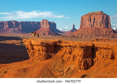 NAVAJO TRIBAL PARK, USA - SEPTEMBER 28, 2017: The John Ford's viewpoint inside the Monument Valley Navajo Tribal Park with a Navajo Horseman staging the scene of the movie Stagecoach, Arizona, USA.