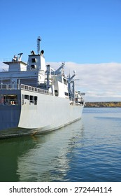 Naval auxiliary ship in the bay.