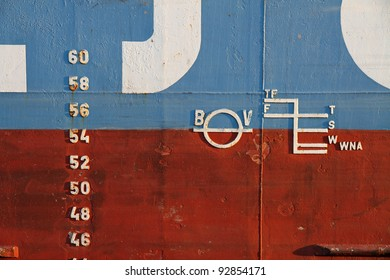 Naval markings on the outside of a ship. Markings for draught and loading.