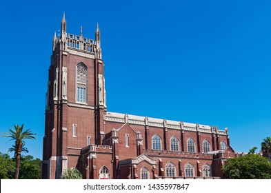 nave and bell tower exterior of landmark neo-gothic church  in new orleans louisiana