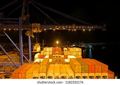 navegantes, santa catarina/brazil - february 05, 2014: containership msc alessia (imo 9225653) discharging containers at navegantes portonave terminal at the itajai  river during nighttime
