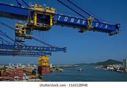 navegantes, santa catarina/brazil - february 06, 2014: container cargo operations at navegantes port at the itajai  river