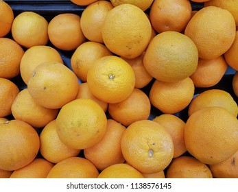 Navel Oranges stacked on a plastic tray and this orange is seedless, tasty, juicy,thick peeled, easy to peel.