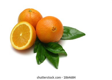 Navel Oranges, whole and half, with leaves, isolated on white