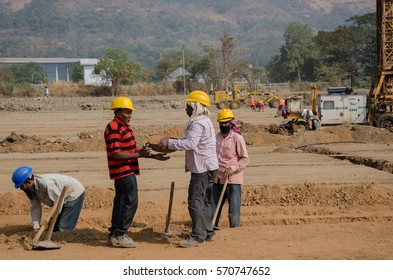 Navi Mumbai, India- 21st January, 2017. Group of construction workers working at a development site.