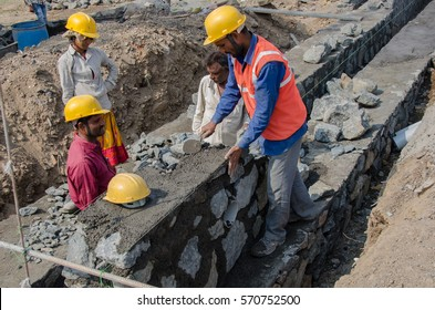 Navi Mumbai, India- 21st January, 2017. Construction workers working at a development site.