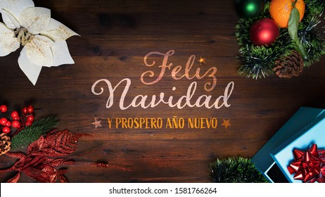 """Feliz Navidad y prospero año Nuevo"" t.i. Merry Christmas and Happy New Year in Spanish language on a wooden background with decoration horizontal for social media and website home and diary pages"