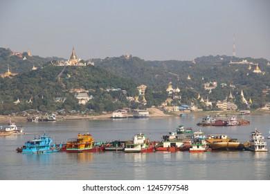 Navigable river Irrawaddy and Mandalay city with golden temples, view from sagaing hill, Sagaing, Mandalay, Myanmar.