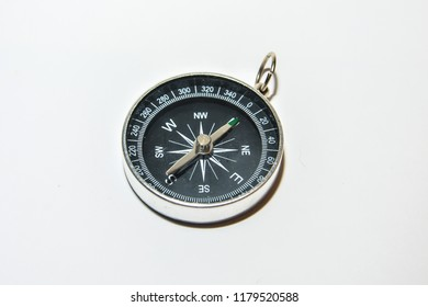 Navigation equipment for orienteering. Compass on white background.