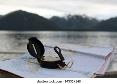 Navigation over sea with compass and map at Chile Fjords