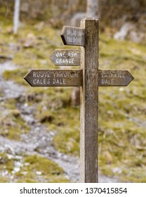 Navigation sign post, pointing in all directions, showing different paths around the Peak District.