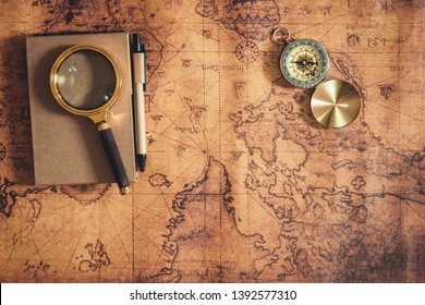 Navigation Travel Explore Journey and Destination Vacation Planning ,Exploration The World for Holiday Trip Concept. Layout of Notebook, Magnifying Glass and Navigator Compass on Global Map Background