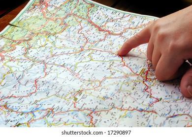 navigation travel map finger pointing