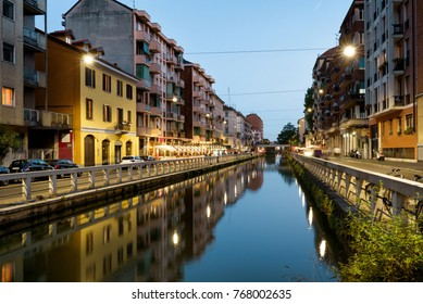 Naviglio Grande canal in the evening in Milan, Italy. Naviglio Grande is one of the main tourist attractions of Milan. Panoramic night view of Milan. Architecture and landscape of Milan.