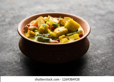 """Navratan Korma is a rich, creamy and flavorful dish that literally translates to nine-gem curry. The """"gems"""" are the fruits, vegetables and nuts that make up the curry. Served in a serving bowl or kara"""