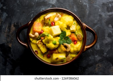 """Navratan Korma is a rich, creamy and flavorful Mughlai dish  from India that literally translates to nine-gem curry. The """"gems"""" are the fruits, vegetables and nuts that make up the curry."""