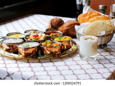 Navratri food thaali platter with sweet lassi.