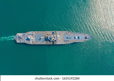 Navy aircraft carrier on the open sea Aerial top view of battleship, Military sea transport, Military Navy Rescue Helicopter on board the battleship deck