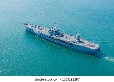 Navy aircraft carrier on the open sea Aerial view of battleship, Military sea transport, Military Navy Rescue Helicopter on board the battleship deck