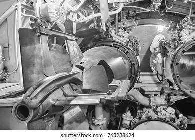 Navy army weapon. Submarine interior. Torpedo tubes. Military vessel. Horizontal