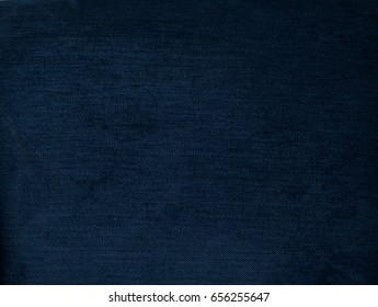 Navy blue background, Texture of dark blue plush fabric, dense velvet. Soft, fleecy cloth. Texture of dark denim nappy textile, closeup, vintage