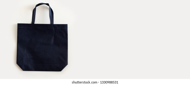 Navy blue  blank tote bag mock up design on white background.