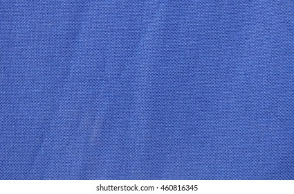 Navy blue fabric with pleats. Abstract background with empty space for text. Plain textile structure.