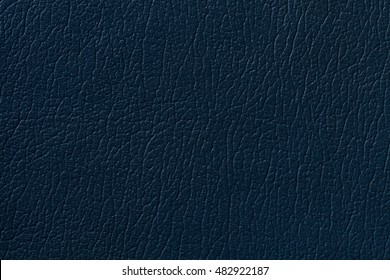 Navy blue leather texture background with pattern, closeup.