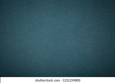 Navy blue matte background of suede fabric, closeup.