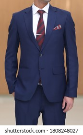 navy blue suit white shirt red maroon striped tie and pocket square