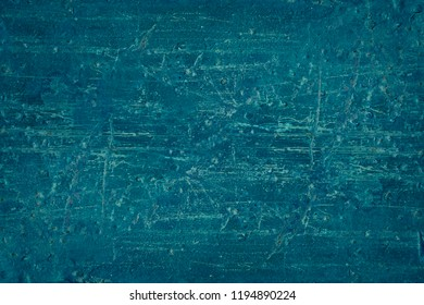 Navy blue or ultramarine painted vintage wall with scratches and splatters
