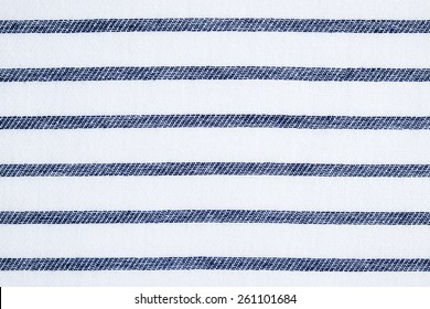 Navy blue and white striped cotton fabric texture