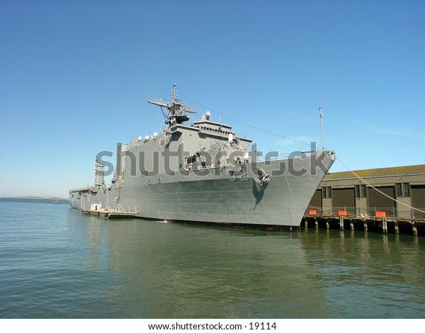 Navy boat docked.