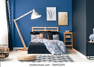 Navy and dark blue master bedroom with feathers pattern bedclothes