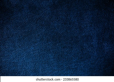 Navy glossy leather texture abstract, iridescent material dark blue toned, rough surface background in horizontal orientation, nobody.