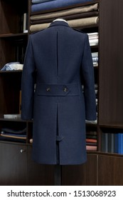 Navy heavy wool bespoke winter-coat on a mannequin. Military cut. Men's Clothing.