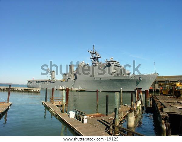 Navy ship at the docks.