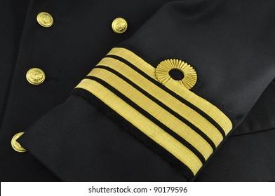 navy uniform with captain rank on a sleeve