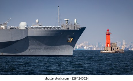 A Navy warship approaches the lighthouse in Yokosuka, Japan.
