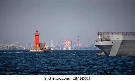 A Navy warship passes the lighthouse in Yokosuka, Japan.