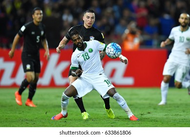 Nawaf Al-Abed no.18(white) of audi Arabia in action during 2018 FIFA World Cup Qualifier Group B between Thailand and Saudi Arabia at the Rajamangala Stadium on March 23, 2017 in Bangkok,Thailand,