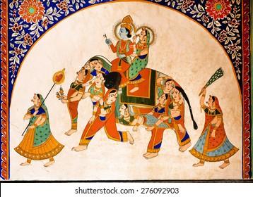 NAWALGARH, INDIA - FEB 6: Old fresco with Krishna and Radha riding the weird elephant with women silhouetts on February 6 2015. With population of 100000, Nawalgarh is education center of Shekhawati